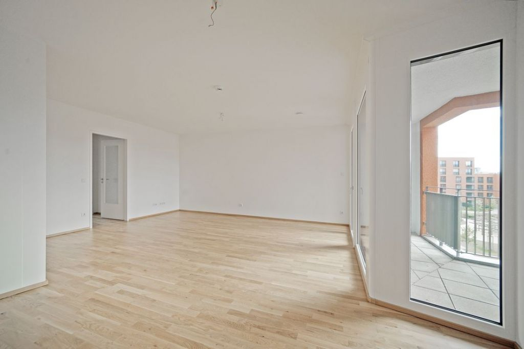 Wohnen 1 1024x682 - Neubau! Erstbezug! Moderne 3-Zimmer-Wohnung mit Einbauküche und Loggia (Whg. 07.12)